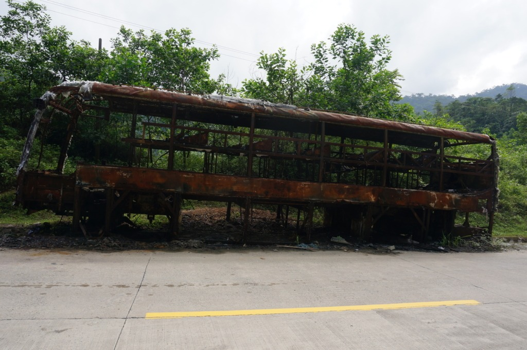 Burned down bus on the road between Kham Duc and Dak Glei