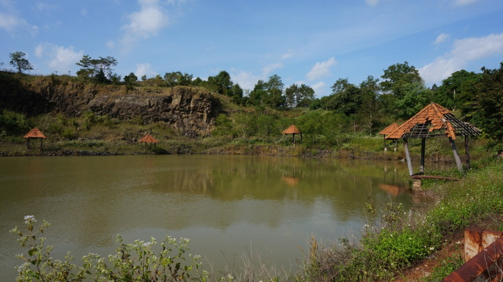 Small lake and broken rest hust close to Phu Cuong waterfall