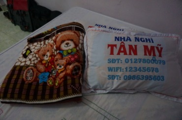 Wifi code on the pillow, and kitsch blanket
