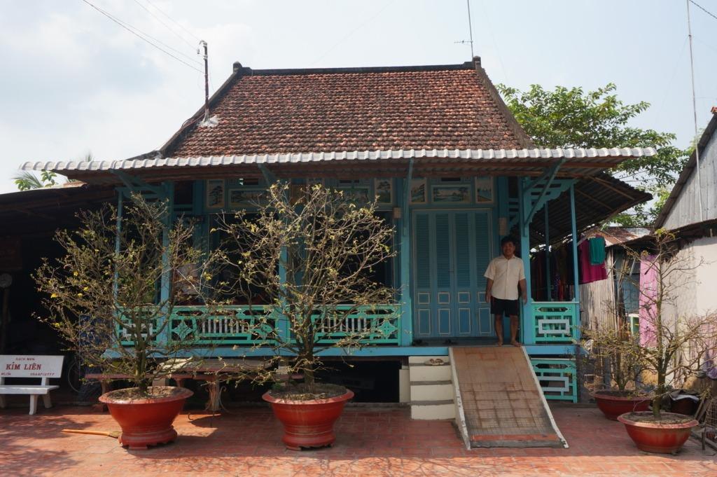 A cute blue wooden house