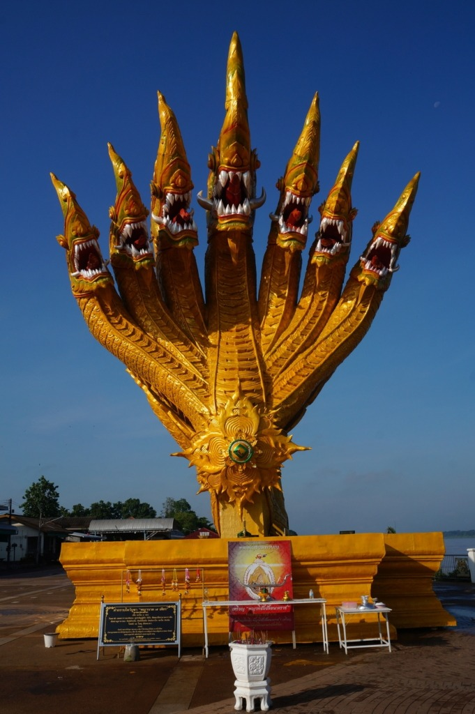 Statue in front of a temple in Phon Phisai